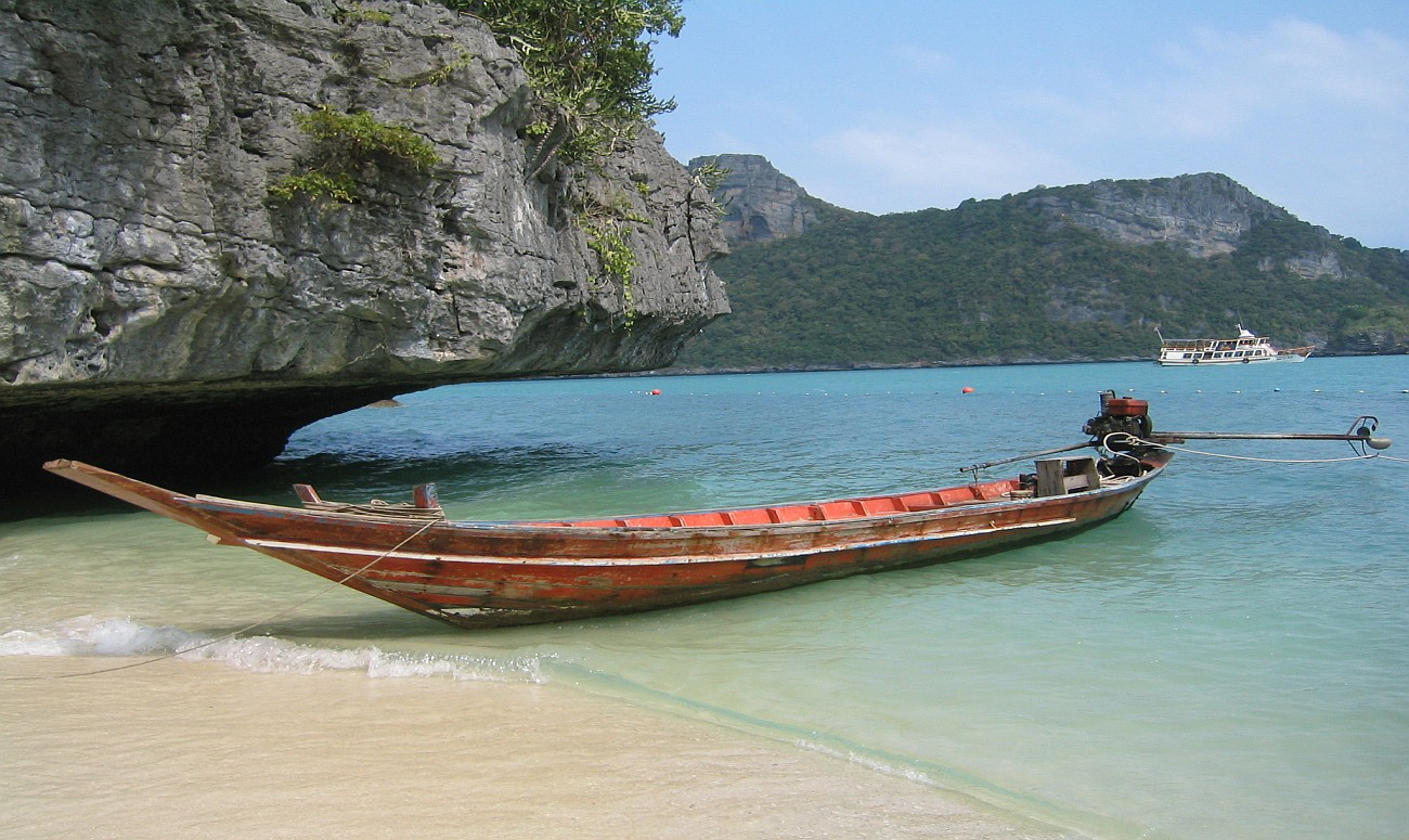 остров лодка скалы море
